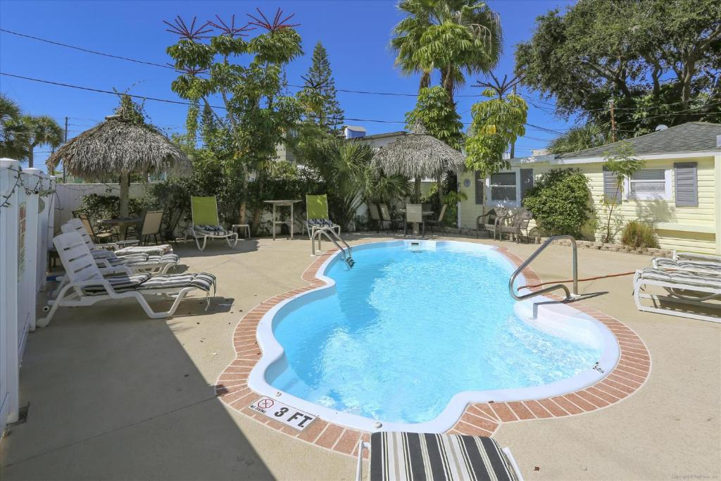 The swimming pool at or close to The Cottages at Madeira Beach