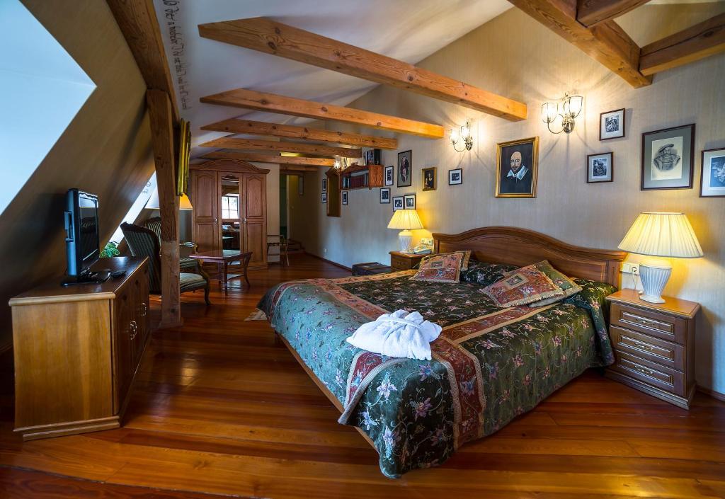 Cama o camas de una habitación en Shakespeare Boutique Hotel