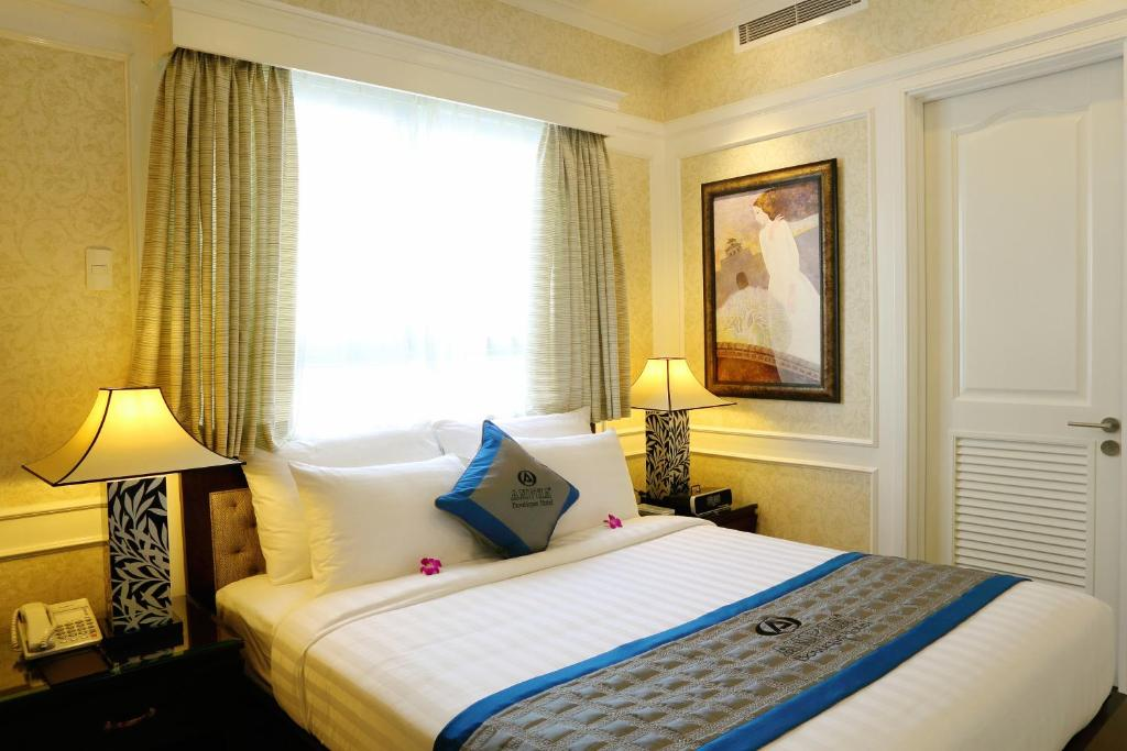 A bed or beds in a room at Anpha Boutique Hotel