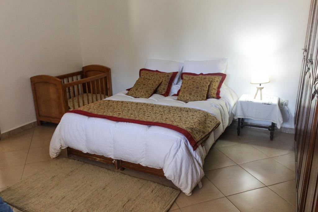 A bed or beds in a room at APPARTEMENT LE BIEN ETRE