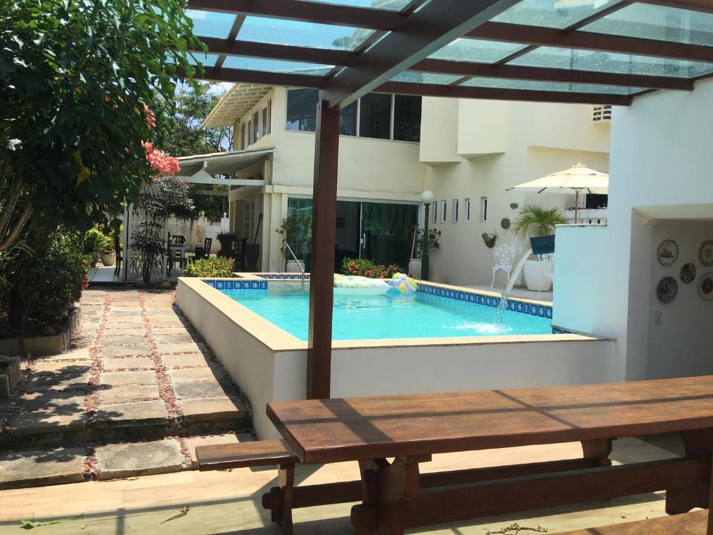 The swimming pool at or close to OÁSIS SALVADOR-BAHIA
