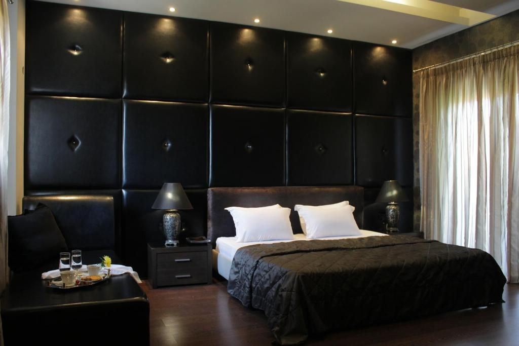 A bed or beds in a room at Galaxy Design Hotel
