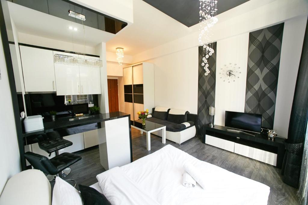 Televizorius ir (arba) pramogų centras apgyvendinimo įstaigoje Best Rest Apartments Old Town