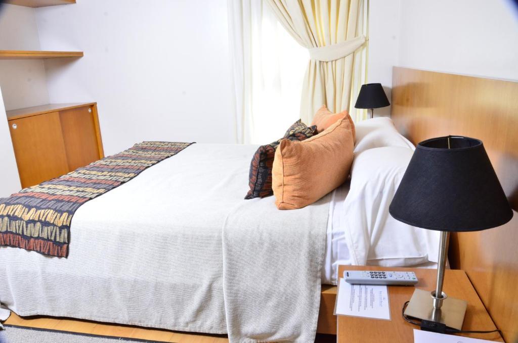 Cama ou camas em um quarto em Telmho Hotel Boutique