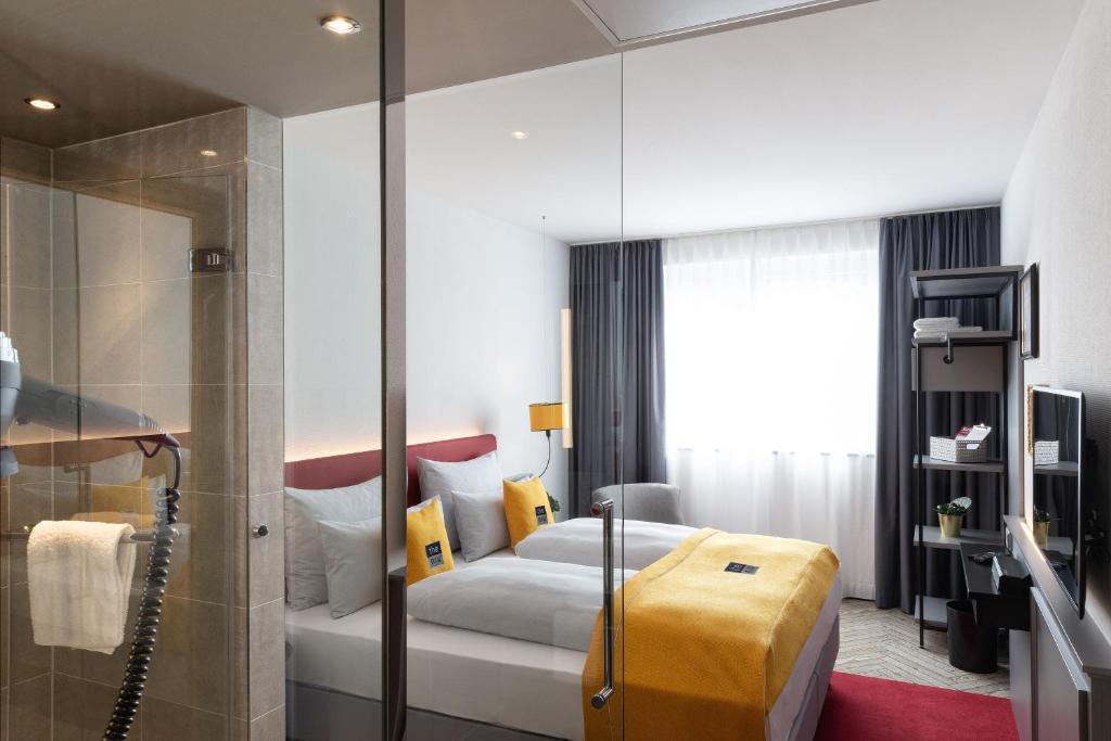 Ein Bett oder Betten in einem Zimmer der Unterkunft the niu Franz