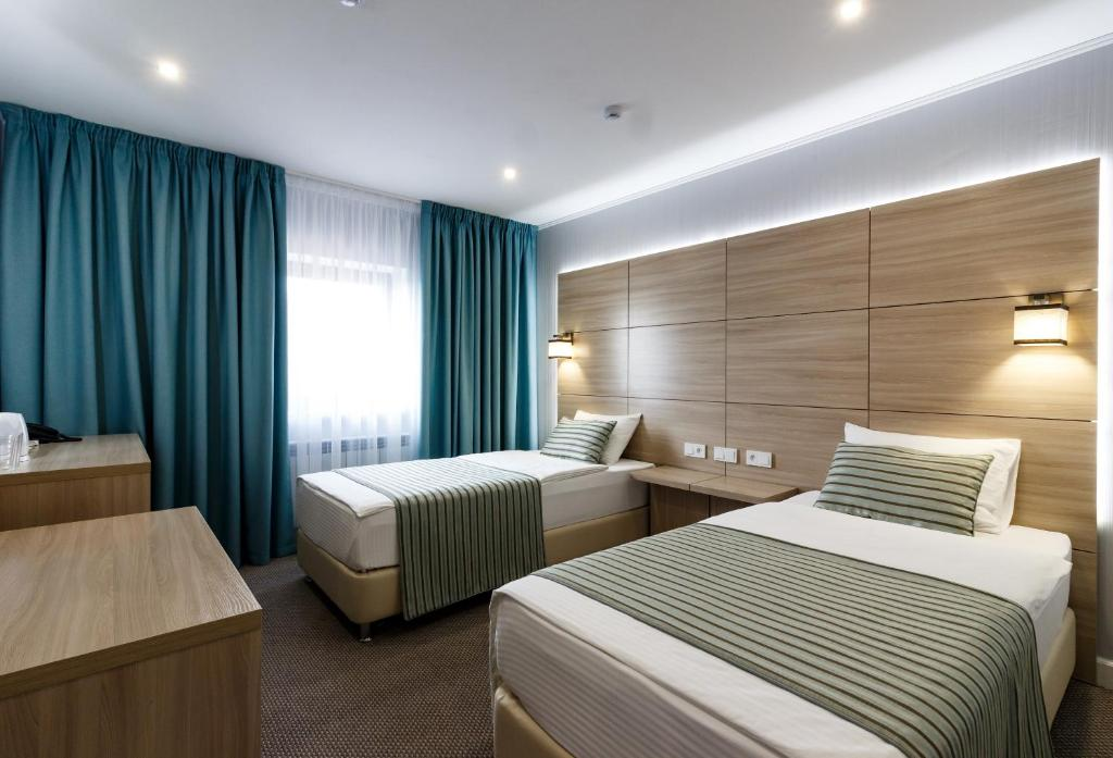 Кровать или кровати в номере Интер Отель