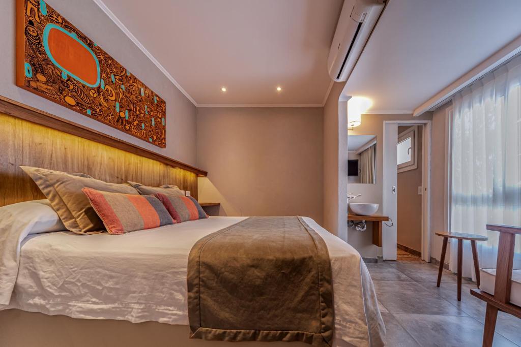 Una cama o camas en una habitación de Hotel Romina