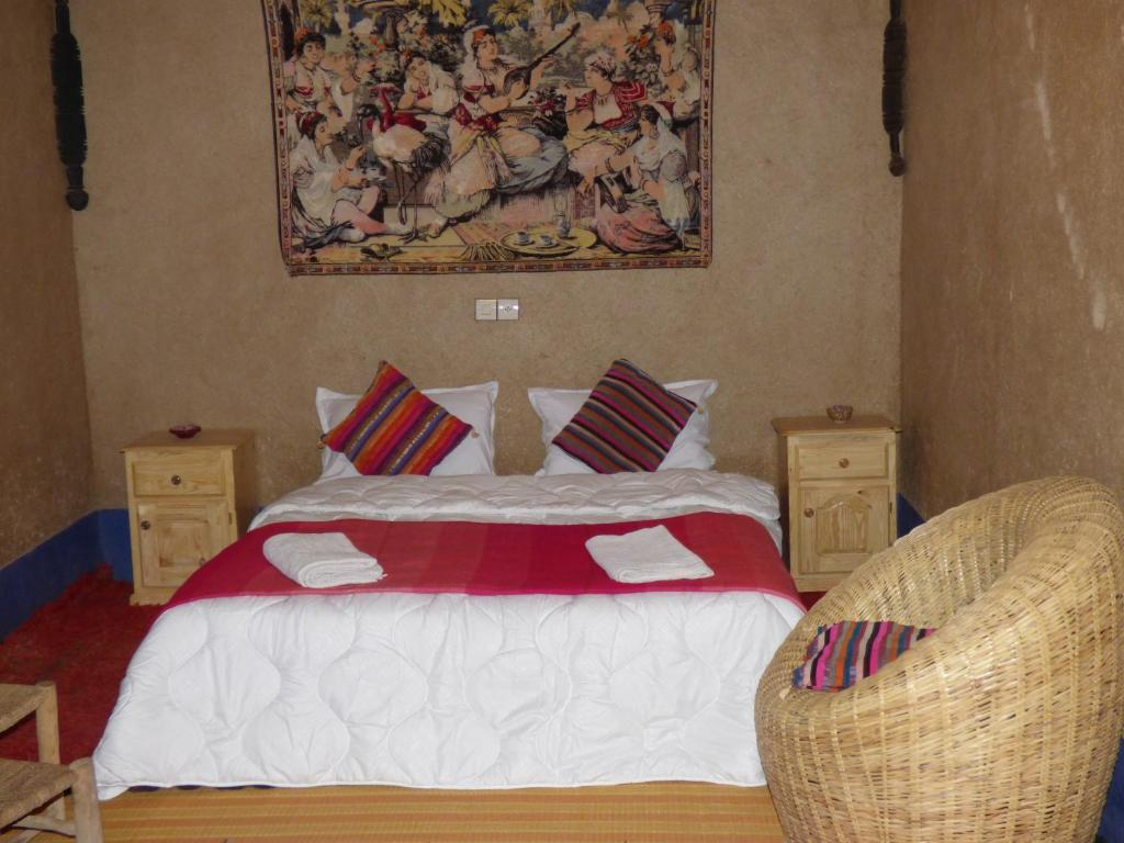 A bed or beds in a room at Planet Sahara