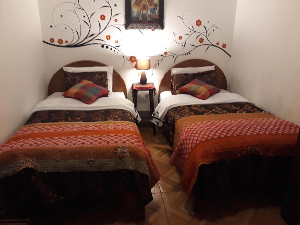 A bed or beds in a room at Mallku Guest House