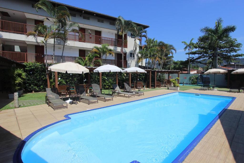 The swimming pool at or near Hotel Ilhas do Caribe