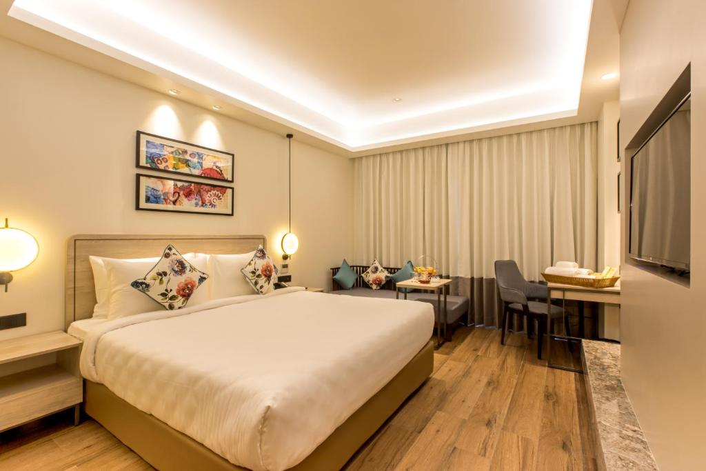 A bed or beds in a room at SG'S GreenOtel