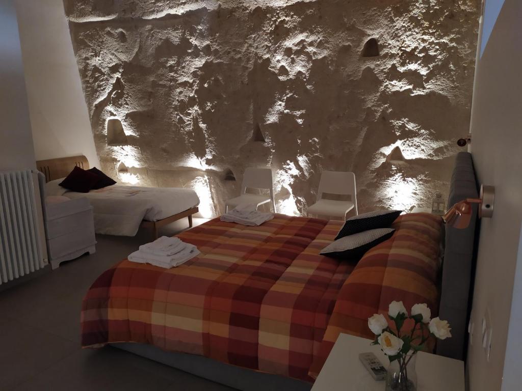 Letto o letti in una camera di La casa nella roccia