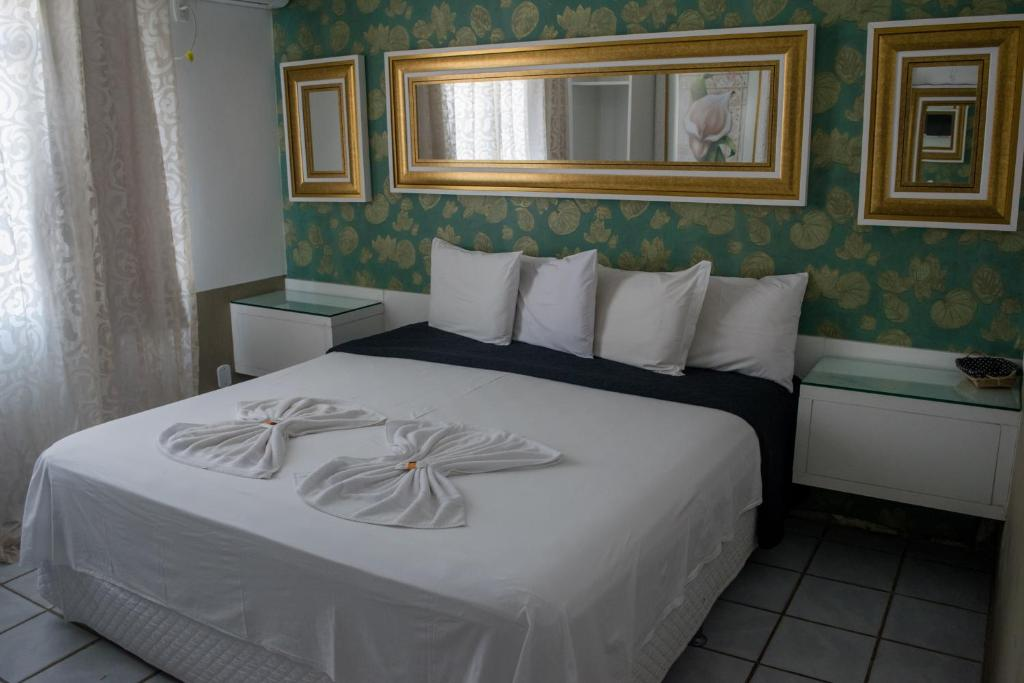 A bed or beds in a room at Rolim Palace Hotel
