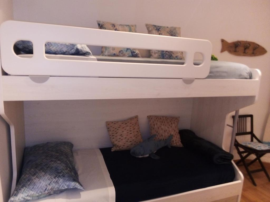 A bed or beds in a room at Acquario Inn Genova House
