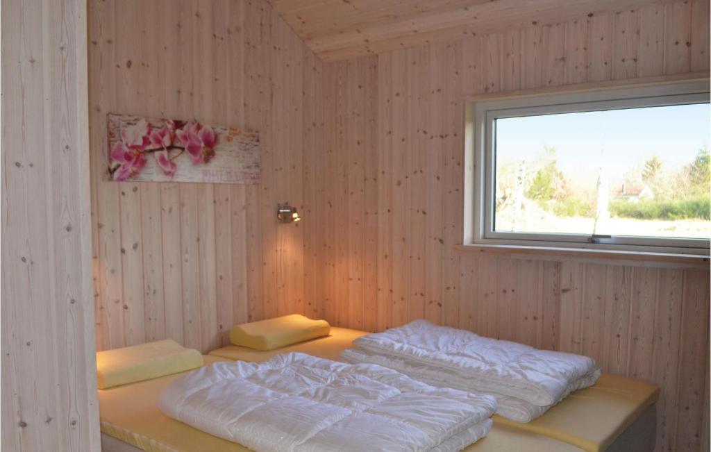 Four-Bedroom Holiday home Glesborg with a room Hot Tub 07