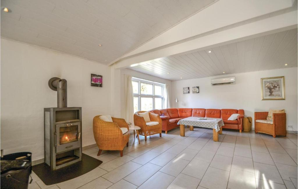 Four-Bedroom Holiday home Ebeltoft with a Fireplace 04