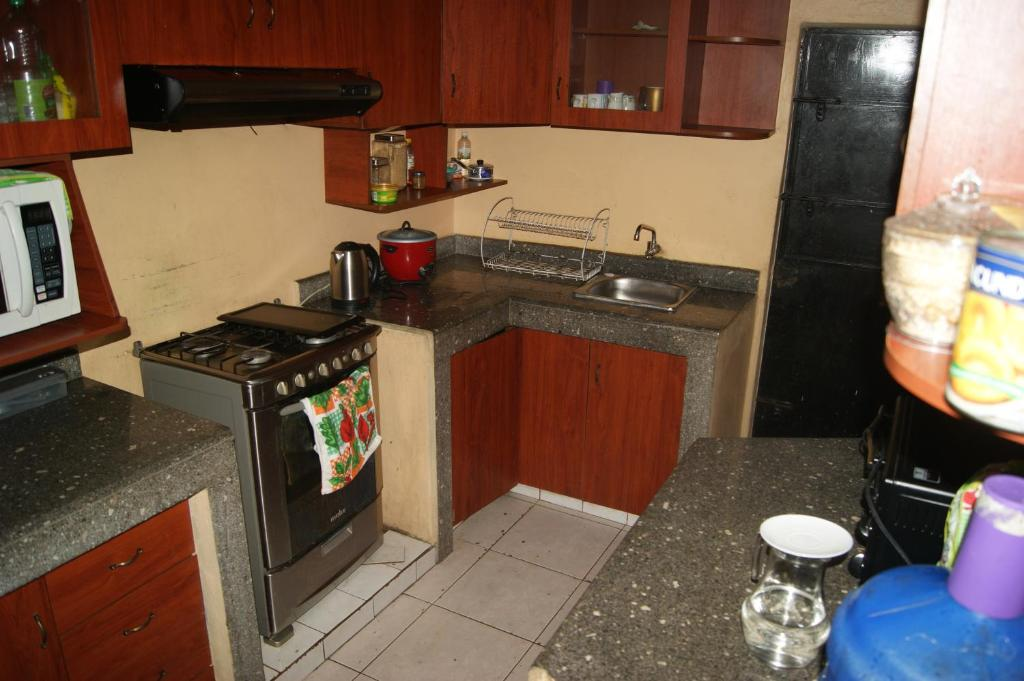 A kitchen or kitchenette at Mignay Backpacker