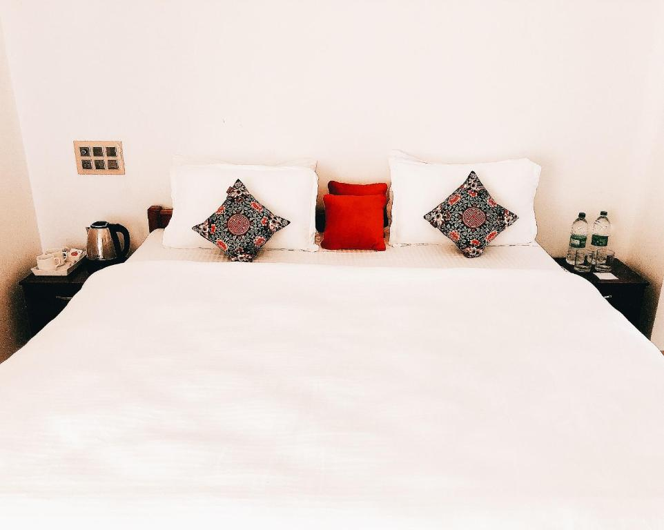 A bed or beds in a room at Zen Kochi Boutique Home