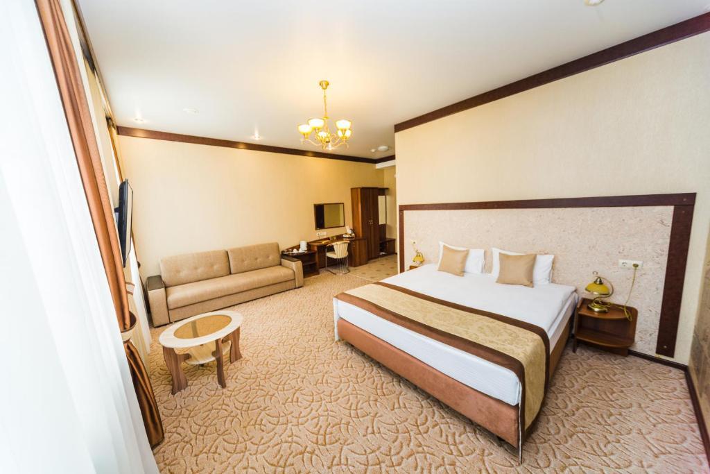 Кровать или кровати в номере Valeri Classic
