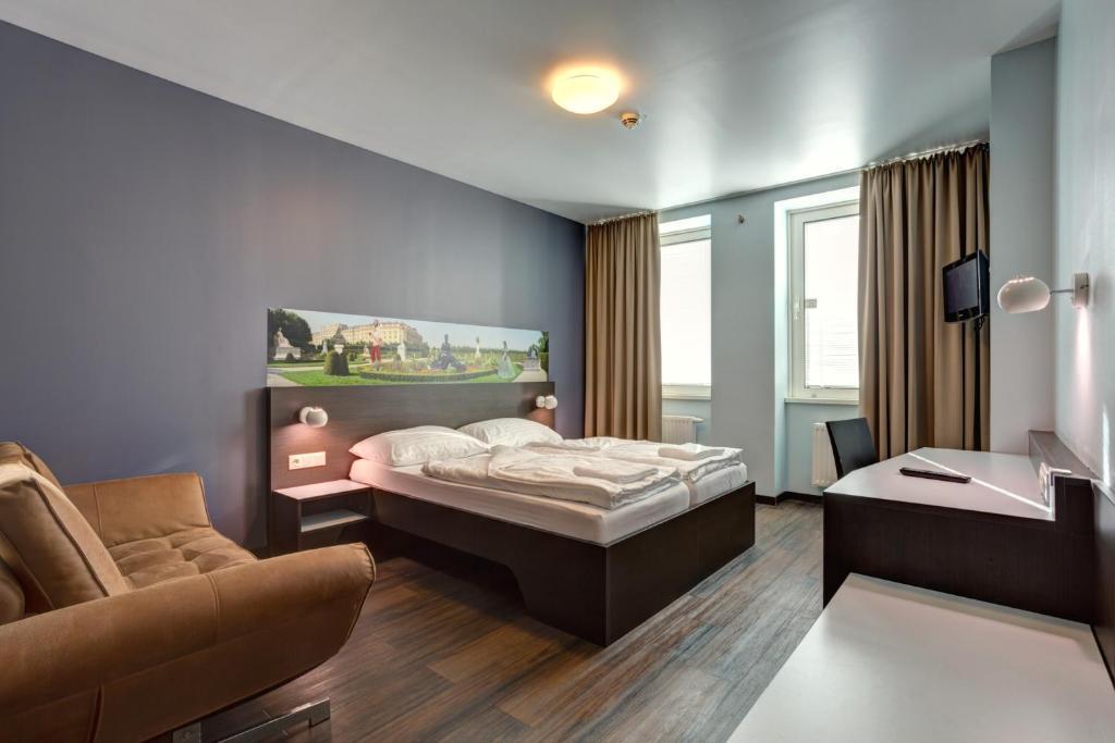 Letto o letti in una camera di MEININGER Hotel Wien Downtown Sissi