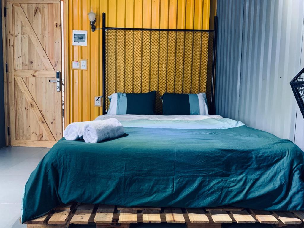A bed or beds in a room at Container House in Da Nang