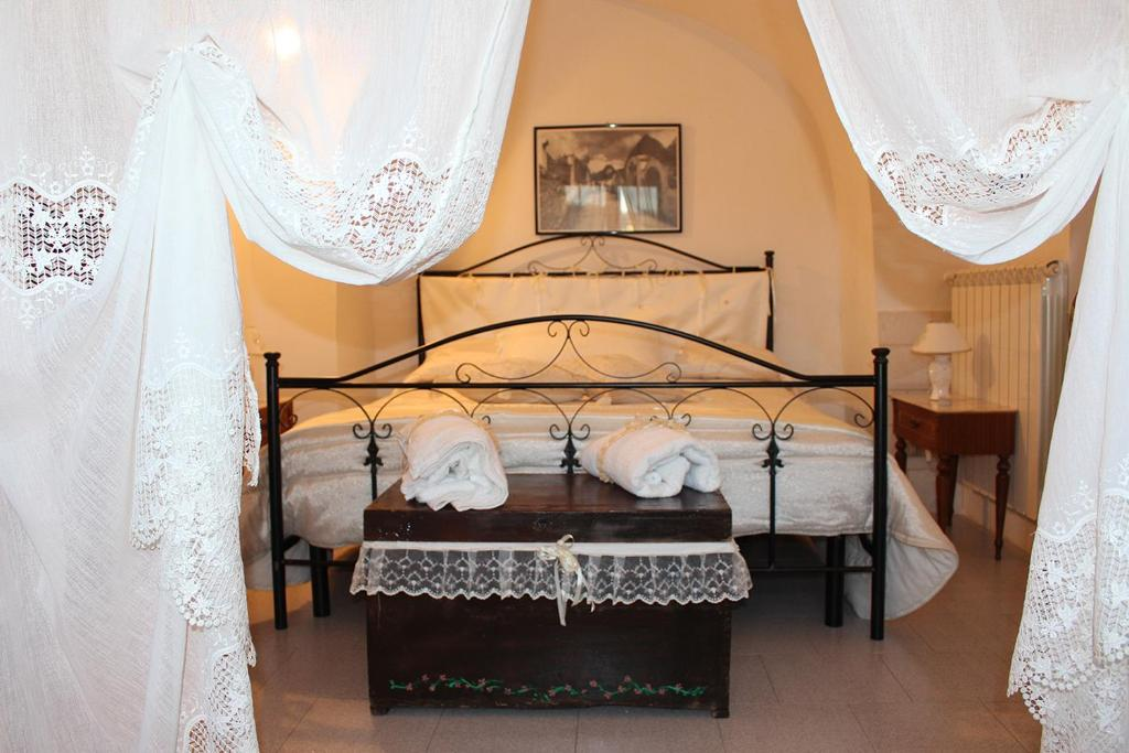 A bed or beds in a room at Trulli di Rosa