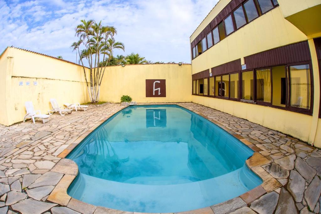 The swimming pool at or near Pousada H Guaruja