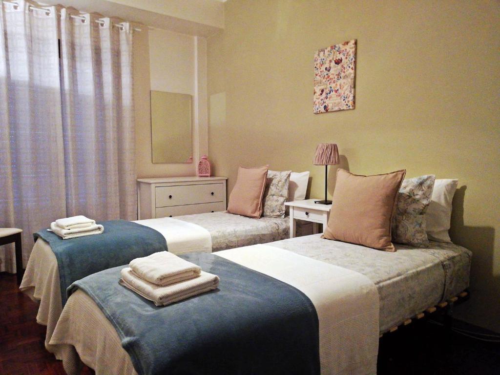 Uma cama ou camas num quarto em TripGeo Apartment Roma