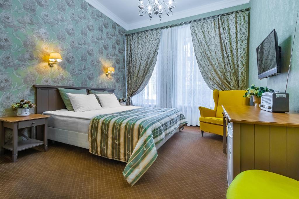 Кровать или кровати в номере Блюз на Невском