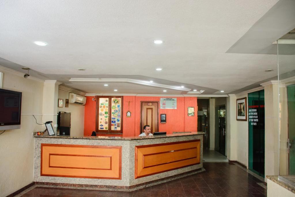 The lobby or reception area at Hotel Dez De Julho
