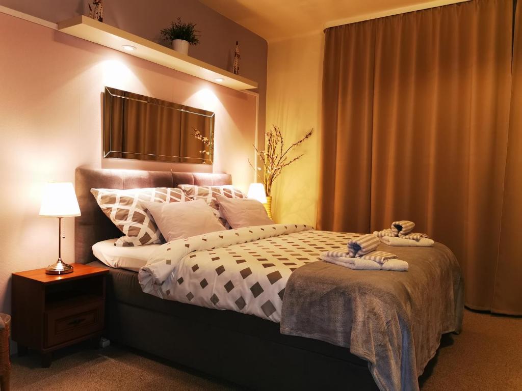 Un ou plusieurs lits dans un hébergement de l'établissement Pension Villa Marit