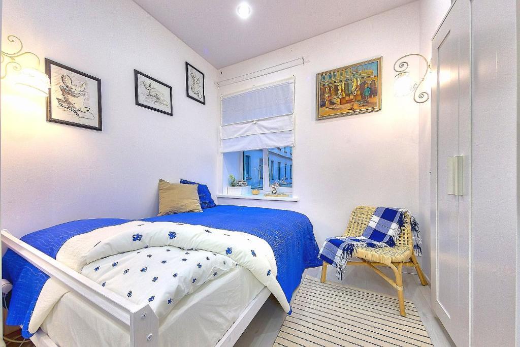Кровать или кровати в номере MouseHouse на Невском.