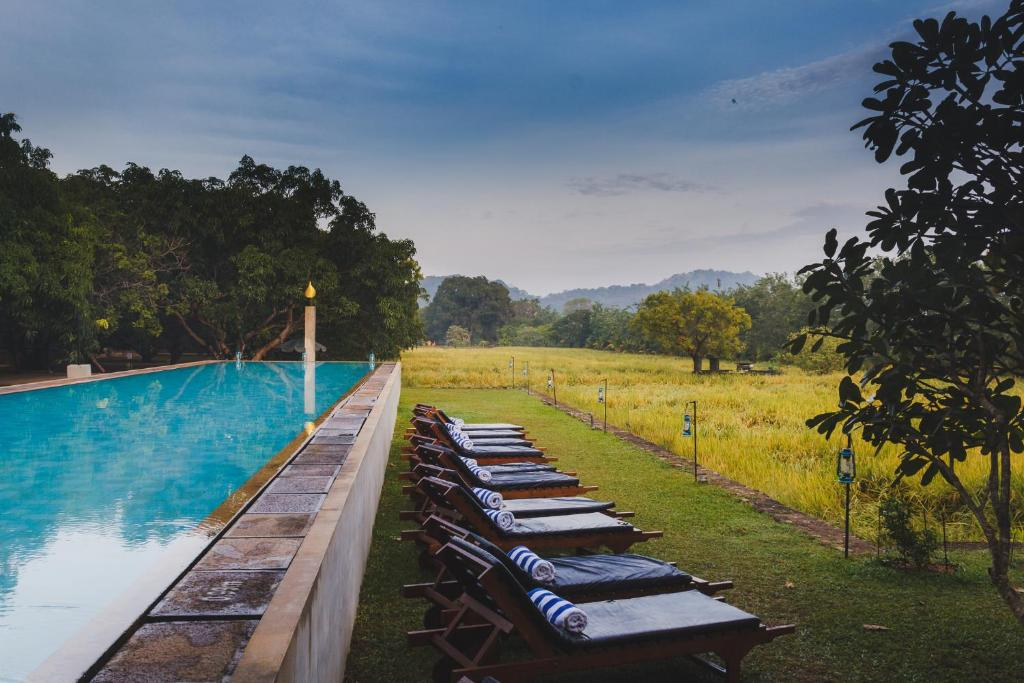 The swimming pool at or close to Sigiriana Resort by Thilanka