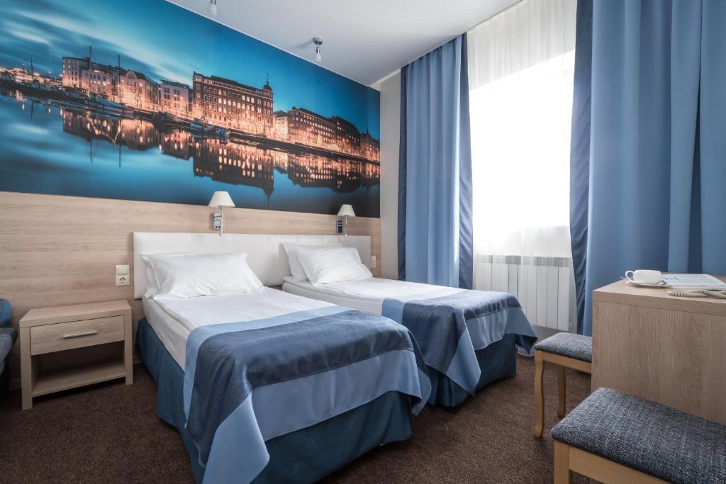 Кровать или кровати в номере Северная Корона