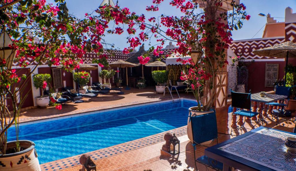 The swimming pool at or near Le Petit Riad