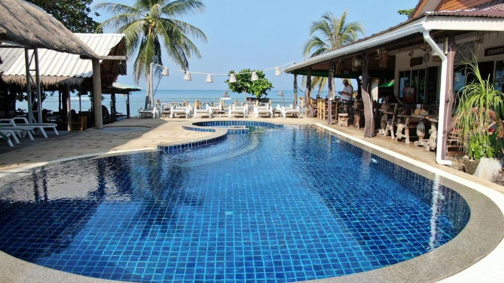 The swimming pool at or near Lanta New Coconut Bungalow