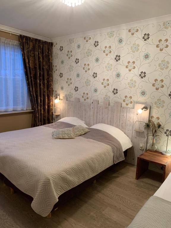 Un ou plusieurs lits dans un hébergement de l'établissement Cenza Apartment