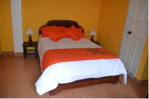 A bed or beds in a room at Hotel El Belen