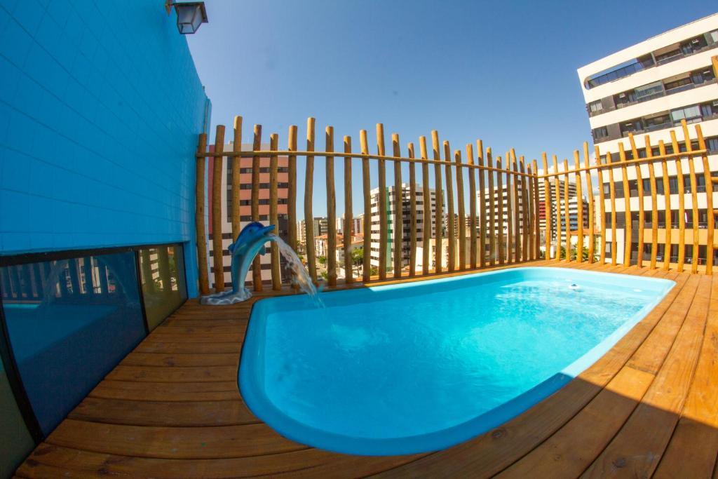 The swimming pool at or near Pousada Capital das Águas