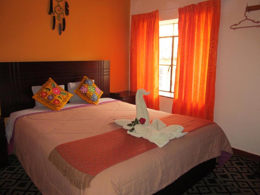 Cama o camas de una habitación en The New Paradise Cusco