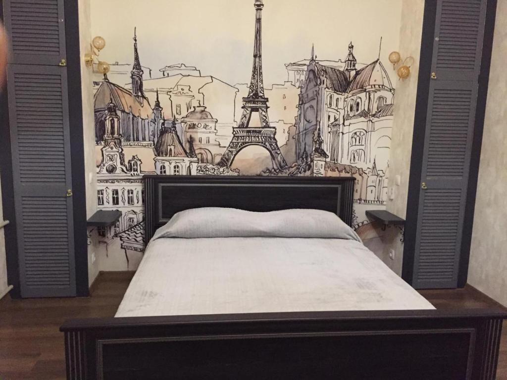 A bed or beds in a room at STERILE Premium Apartment Mariupol in the center Paris style
