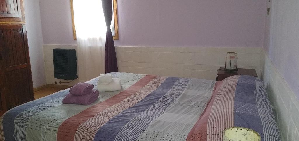Una cama o camas en una habitación de Casa Nona Rosa