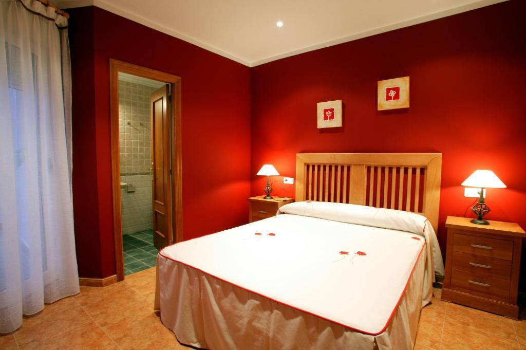 Cama o camas de una habitación en APARTAMENTOS HOTEL 77