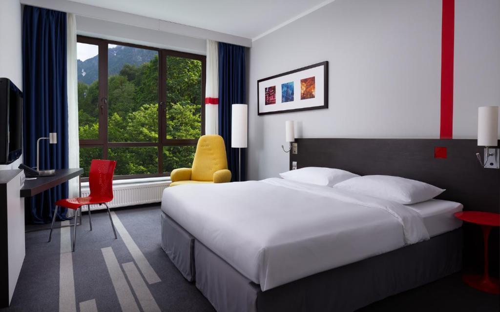 Кровать или кровати в номере Парк Инн от Рэдиссон Роза Хутор