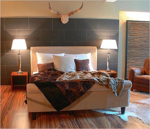 Ein Bett oder Betten in einem Zimmer der Unterkunft Elements Hotel