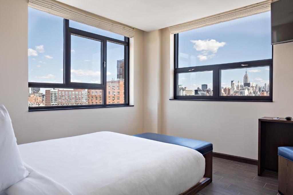 Ein Bett oder Betten in einem Zimmer der Unterkunft Orchard Street Hotel