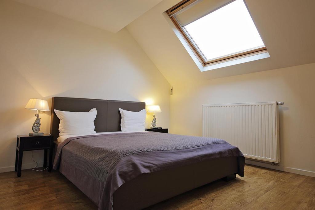 Cama ou camas em um quarto em B&B Le Lys d'or