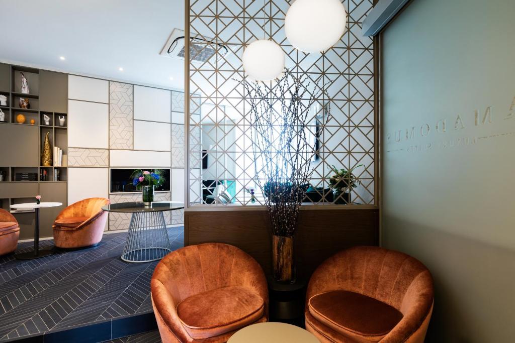 Lobby/Rezeption in der Unterkunft Amadomus Luxury Suites