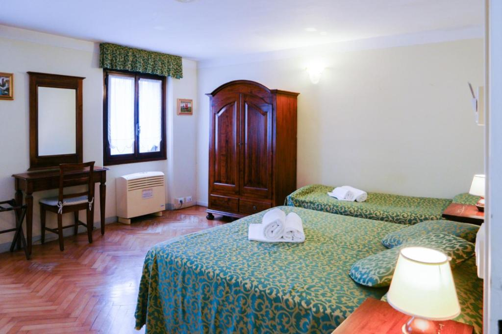 A bed or beds in a room at Corte Canal Venice