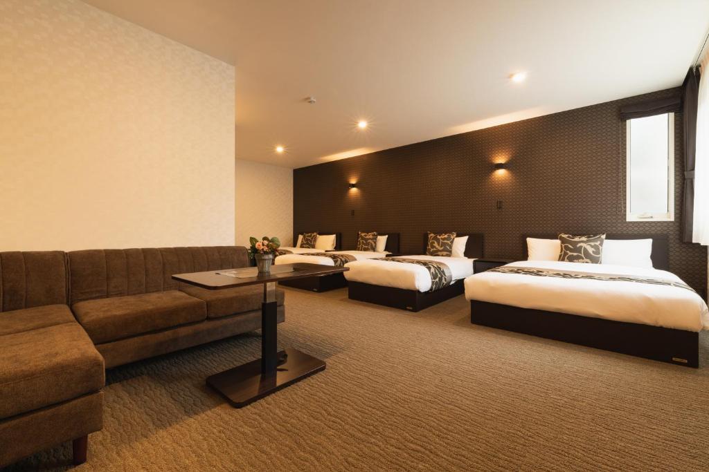 GRAND BASE NAGASAKIEKIMAEにあるベッド
